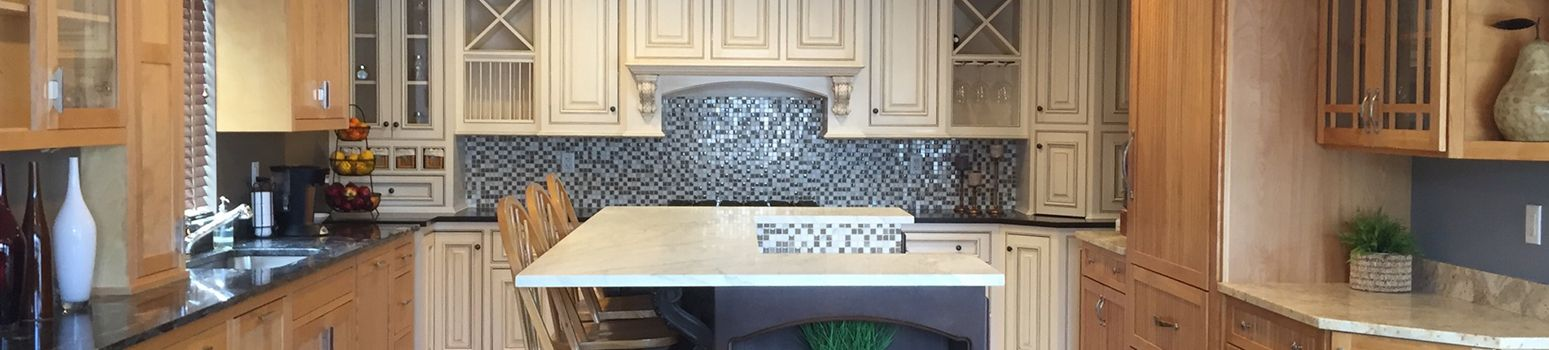 Kitchen with granite counter tops and wood cabinets